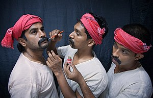 English: Actors in the makeup process of a Koo...