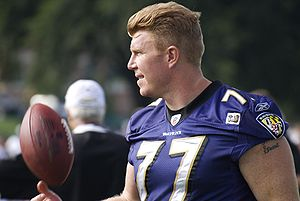 Baltimore Ravens center Matt Birk tosses a foo...