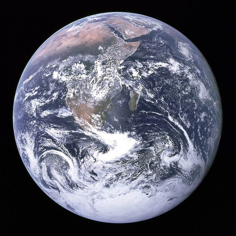 """""""The Blue Marble"""" photograph of Earth, taken by the Apollo 17 lunar mission. The Arabian peninsula, Africa and Madagascar lie in the upper half of the disc, while Antarctica is at the bottom."""