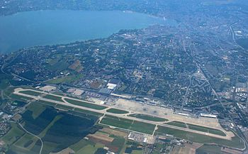 Geneva International Airport, with the city of...