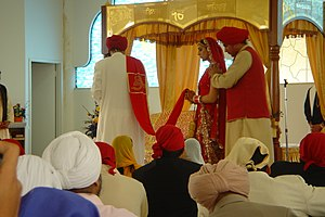 A Sikh couple getting married. Anand Karaj cer...