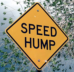 "English: A ""speed hump"" sign in Sant..."
