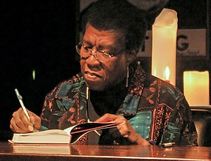 Octavia Estelle Butler signing a copy of Fledg...