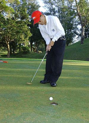 Golf player putting green 2003