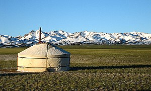 Yurt with the Gurvansaikhan Mountains behind, ...