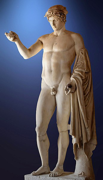 a white marble statue of a man with one hand lifted