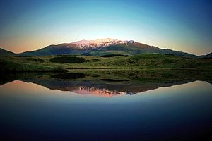 Mt. Snowdon reflected in the waters of Llyn y ...