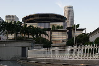 A view of the Supreme Court Building with Parliament House in the foreground