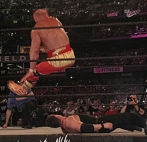 Hulk Hogan hitting his infamous Leg Drop on Vi...