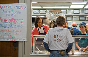 English: Michelle Obama served food at Miriam'...
