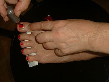 Applying nail polish on toes