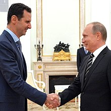 Assad greeting Russian President Vladimir Putin, 21 October 2015