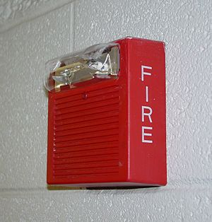 A fire alarm that warns people if a building i...