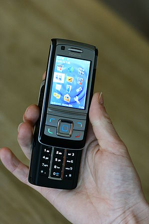 A Nokia 6280 mobile phone (A1-edition), an UMT...