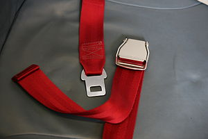 Seat belt on an airplane, open