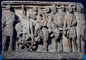 Menelaus and Meriones lifting Patroclus' corps...