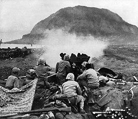 37mm Gun fires against cave positions at Iwo Jima.jpg
