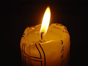 An Advent candle burning on the fourth day of ...