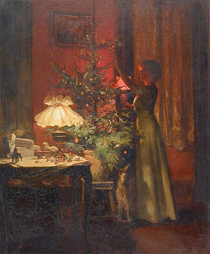English: A Young woman decorates the Christmas...