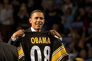 Barack Obama holding up a Pittsburgh Steelers ...
