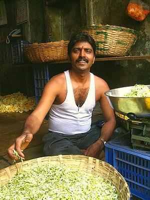 A flower seller at Dadar Station Phul Galli. N...