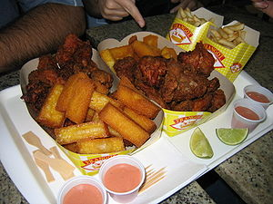 Polenta, French fries, and fried chicken at a ...
