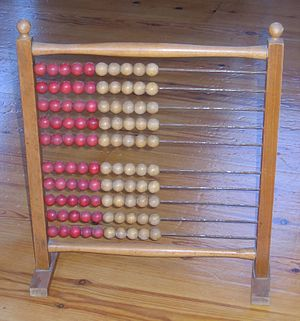 An abacus from a Danish elementary school. Early 20th century. Size: 40 cm wide, 46 cm high.