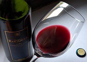 Tempranillo varietal wine bottle and glass, sh...