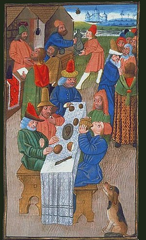 Medieval French peasants enjoying a meal