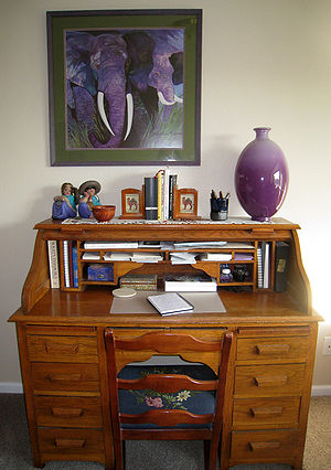 Photograph of a rolltop writing desk and surro...