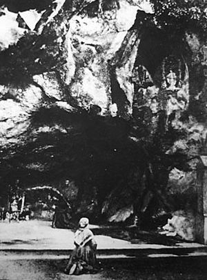Bernadette Soubirous in the grotto of Lourdes,...