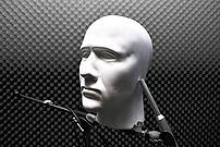 A dummy head being used as a binaural micropho...