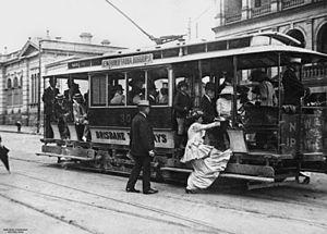 English: Woman getting on a tram, Brisbane, 19...