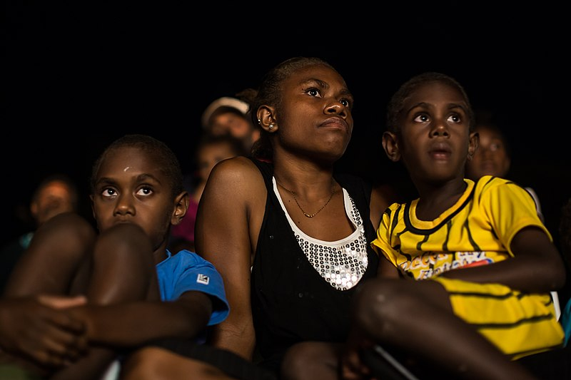 File:An eager crowd watches on at the first public screening of the 2013 Namatan Short Film Festival was in Norsup on Malekula Island. (10666256764).jpg