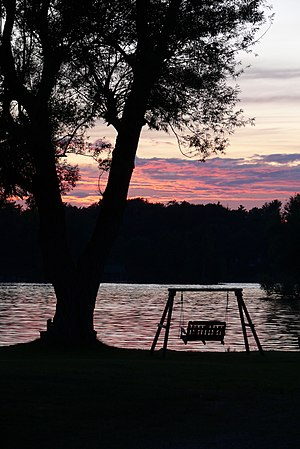 English: Porch swing at sunset along the Saint...