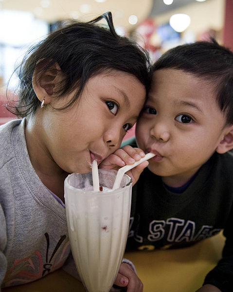 File:Children sharing a milkshake.jpg