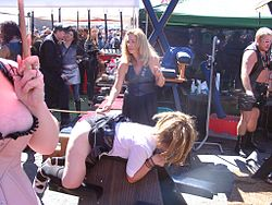 Demonstration of caning at the Folsom Street Fair 2004 in San Francisco