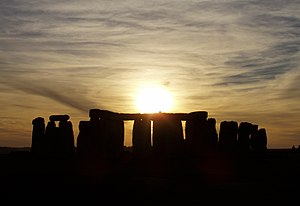 Stonehenge at sunset on a cloudy day.