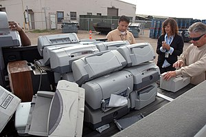 San Diego (May 13, 2010) Workers gather printe...