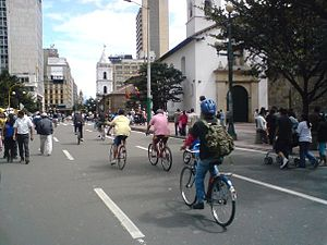 English: People riding bikes on the streets of...