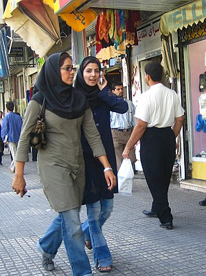 Two young Iranian women walking down the stree...