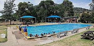 Instructors teach children how to swim