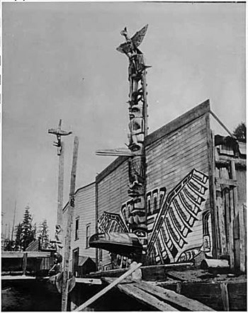 Totem poles in front of houses in Alert Bay, B...