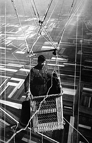 Close-up view of an American major in the basket of an observation balloon  flying over territory near front lines. 33d652796f