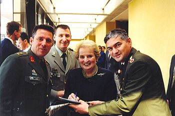 English: Madeleine Albright with NATO officers