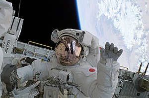 Japanese astronaut Soichi Noguchi waves during...