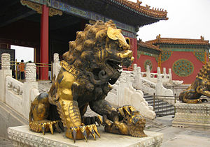 Statue of golden lion with cub, in Forbidden C...