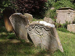 English: Tombstones at Dyrham Seriously leanin...