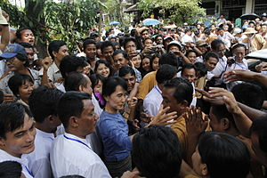 Aung San Suu Kyi greeting supporters from Bago...