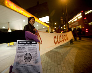 Protesters with banners and leaflets closing d...